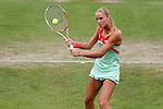 Nederland, Rosmalen, 20 juni 2012.Seizoen 2011/2012.Tennis Unicef open 2012\.Arantxa Rus uit Nederland in actie met de bal