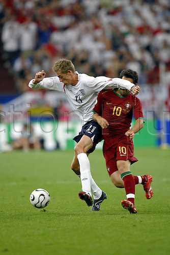 1 July 2006: England striker Peter Crouch catches Hugo Viana with his elbow during the Germany 2006 FIFA World Cup Quarter Final match between England and Portugal played at the FIFA World Cup Stadium, Gelsenkirchen. Portugal won the game 3-1 on penalties after it finished 0-0 Photo: Neil Tingle/Action Plus..soccer football player 060701 dangerous face