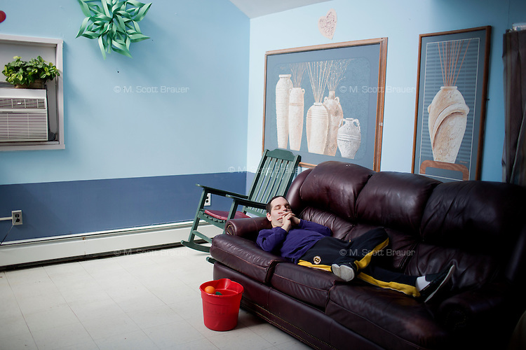 Michael Martin naps after lunch in the residences in Malone Park at the Fernald Developmental Center in Waltham, Massachusetts, USA.  Michael, 52, cannot speak.