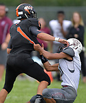 Dupo's Jake Taylor (right) pulls down Wesclin running back Jamie Kattenbraker. Wesclin defeated Dupo 34-30 on Saturday August 31, 2019 in a game that was stopped Friday night at halftime due to storms. <br /> Tim Vizer/Special to STLhighschoolsports.com