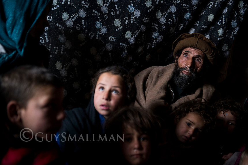 Children in an unnamed refugee camp in district 5 of Kabul at the onset of winter 8-1-14 Mohamad Akbar with some of his 14 grandchildren. They came to Kabul from Jalalabad looking for work because the family was destitute and starving. Their situation has not improved.