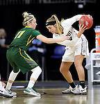 SIOUX FALLS, SD: MARCH 4: Caitlyn Tolen #12 of IUPUI holds the ball away from Taylor Thunstedt #11 of North Dakota State on March 4, 2017 during the Summit League Basketball Championship at the Denny Sanford Premier Center in Sioux Falls, SD. (Photo by Dick Carlson/Inertia)