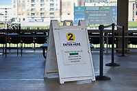 Sections of the concourse are marked with signs asking people to stay within certain areas to comply with social distancing rules during the Southern Collegiate Baseball League game between the Concord Athletics and the Piedmont Pride at Truist Field on July 3, 2020 in Charlotte, NC. (Brian Westerholt/Four Seam Images)