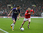 Chris Basham of Sheffield Utd and Oliver McBurnie  of Barnsley during the championship match at the Oakwell Stadium, Barnsley. Picture date 7th April 2018. Picture credit should read: Simon Bellis/Sportimage