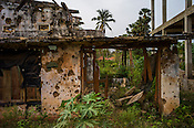Bullet ridden walls of the abandoned house seen by the side of the road where the last battle between the LTTE and the Sri Lankan army was fought, along the highway in Kilinochchi, in northern Sri Lanka. Photo: Sanjit Das/Panos