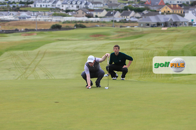 Eanna Griffin (Waterford) on the 1st green during Matchplay Round 1 of the South of Ireland Amateur Open Championship at LaHinch Golf Club on Friday 24th July 2015.<br /> Picture:  Golffile | Thos Caffrey