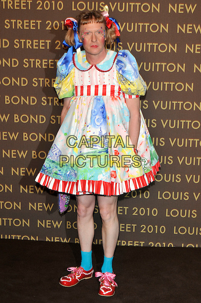 GRAYSON PERRY (as CLAIRE, his female alter-ego).attends the launch of the Louis Vuitton Bond Street Maison in London, England, UK, May 25th, 2010..full length artist cross-dresser bunched blue red green dress ankle socks pink ribbons bows shoes art work painting painted print picture .CAP/PL.©Phil Loftus/Capital Pictures.