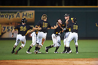 Bradenton Marauders Kevin Kramer (14) gets mobbed by teammates, including Wyatt Mathisen (helmet), Pablo Reyes (15), Michael Suchy (13), and Jordan Ludlow (26), after a walk off hit during a game against the Palm Beach Cardinals on August 8, 2016 at McKechnie Field in Bradenton, Florida.  Bradenton defeated Palm Beach 5-4.  (Mike Janes/Four Seam Images)
