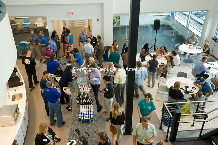 SEYMOUR, CT-0731117JS05-- Guests mingle prior to the  opening of Connecticut Basement Systems' new 77,000 square-foot building in Seymour on Tuesday. The new building will be dedicated to education, entrepreneurship and economic success. Jim Shannon Republican-American