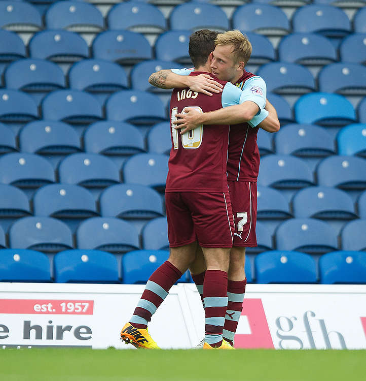 Burnley's Scott Arfield celebrates scoring the opening goal with team-mate Danny Ings<br /> <br /> Photo by Stephen White/CameraSport<br /> <br /> Football - The Football League Sky Bet Championship - Leeds United v Burnley - Saturday 21st September 2013 - Elland Road - Leeds<br /> <br /> &copy; CameraSport - 43 Linden Ave. Countesthorpe. Leicester. England. LE8 5PG - Tel: +44 (0) 116 277 4147 - admin@camerasport.com - www.camerasport.com