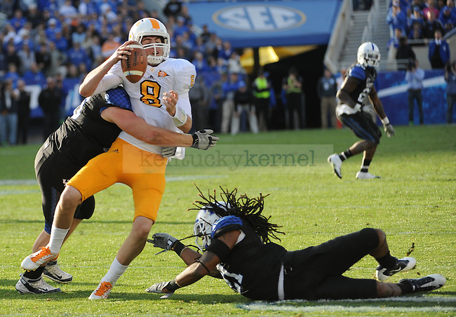UK Defensive Tackle Luke McDermott and Linebacker Winston Guy sack Tennessee Quarterback Tyler Bray during the fourth quarter of the University of Kentucky football game against Tennessee at Commonwealth Stadium in Lexington, Ky., on 11/26/11. UK won the game 10-7. Photo by Bob Weaver | Staff