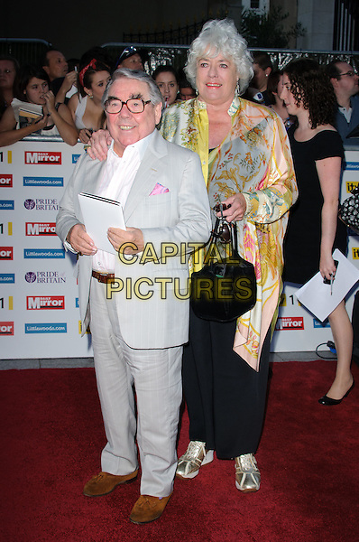 Ronnie Corbett & Anne Hart.'The Daily Mirror's Pride Of Britain Awards 2011' at Grosvenor House Hotel, London, England..3rd October 2011.full length grey gray suit pink shirt yellow print top black trousers tall short married husband wife .CAP/CJ.©Chris Joseph/Capital Pictures.