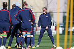 14 October 2014: Christie Rampone (right) leads her team in a stretching exercise. The United States Women's National Team held a training session on the stadium field at Swope Park Soccer Village in Kansas City, Missouri in preparation for the CONCACAF Women's World Cup Qualifying Tournament for the 2015 Women's World Cup in Canada.