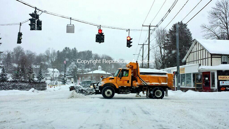WATERTOWN, CT 19 February 2014-021914LW01 - A plow truck clears the intersection of Main Street and Davis Street in Oakville last week.<br />
