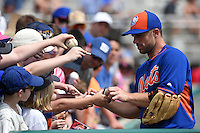 New York Mets third baseman David Wright (5) signs autographs before a Spring Training game against the St. Louis Cardinals on April 2, 2015 at Roger Dean Stadium in Jupiter, Florida.  The game ended in a 0-0 tie.  (Mike Janes/Four Seam Images)