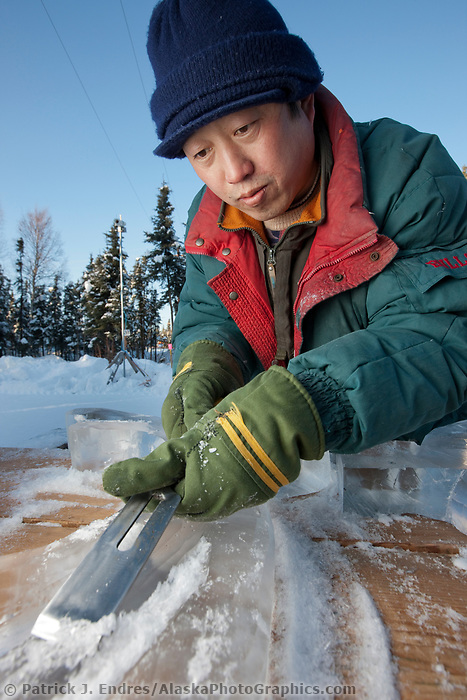 "2009 World Ice Art championships, Fairbanks, Alaska. Multi-block sculpture competition. Realistic category, titled ""The Song of the Earth"" by Chinese sculptors: Wei,Tian Zuo; Feng,Yan Long; Chang, Chun He; Li, Hai. Yan Long carves antlers to be placed on the deer's head later."