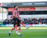 Lincoln City's Bruno Andrade, left, celebrates scoring the opening goal with team-mate Harry Toffolo<br /> <br /> Photographer Chris Vaughan/CameraSport<br /> <br /> The EFL Sky Bet League Two - Lincoln City v Northampton Town - Saturday 9th February 2019 - Sincil Bank - Lincoln<br /> <br /> World Copyright &copy; 2019 CameraSport. All rights reserved. 43 Linden Ave. Countesthorpe. Leicester. England. LE8 5PG - Tel: +44 (0) 116 277 4147 - admin@camerasport.com - www.camerasport.com