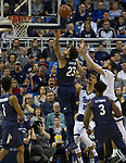 Akron forward Jaden Sayles (23) goes up for a rebound against Nevada in the first half of an NCAA college basketball game in Reno, Nev., Saturday, Dec. 22, 2018. (AP Photo/Tom R. Smedes)