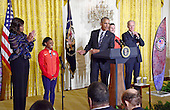 United States President Barack Obama gestures towards American Gold Medal-winning gymnast Simone Biles as he and first lady Michelle Obama welcome the 2016 US Olympic and Paralympic teams to the East Room of the White House in Washington, DC to honor their participation and success in this year's Games in Rio de Janeiro, Brazil.  From left to right: Simone Biles, first lady Michelle Obama, President Obama, US Army Staff Sergeant Josh Brunais, and US Vice President Joe Biden.<br /> Credit: Ron Sachs / Pool via CNP