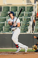 Nick Vickerson (21) of the Hickory Crawdads follows through on his swing against the Kannapolis Intimidators at CMC-Northeast Stadium on May 19, 2014 in Kannapolis, North Carolina.  The Crawdads defeated the Intimidators 10-6.  (Brian Westerholt/Four Seam Images)