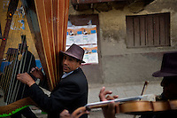 Musicians from the Juventud del Centro group play in the colonial area of Cerro de Pasco, Peru. Under an initiative known as Plan L to expand the open-pit mine in Cerro de Pasco, the colonial area would be destroyed to make way for more mining activity.