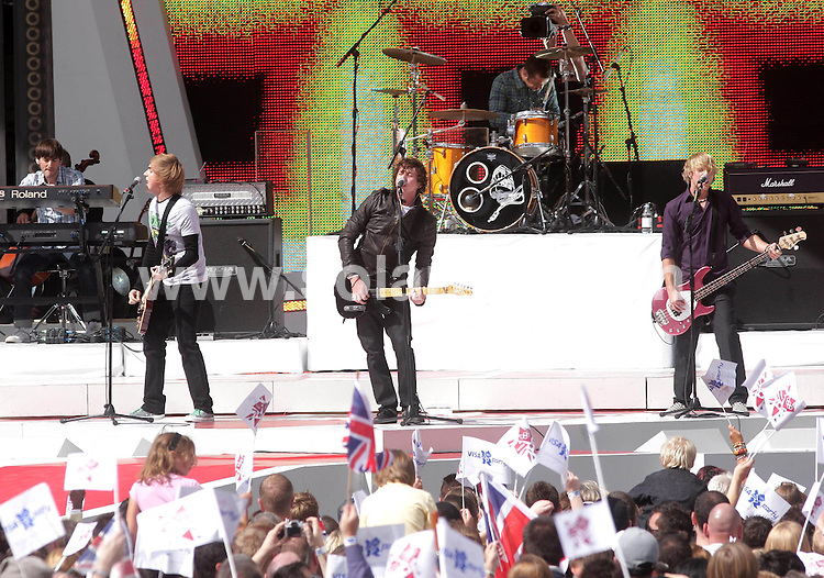 **ALL ROUND PICTURES FROM SOLARPIX.COM**.**NO UK NEWSPAPER PUBLICATION **UK MAGAZINE & SUPPLEMENT PUBLICATION ONLY** AND NO PUBLICATION IN FRANCE, SCANDINAVIA, AUSTRALIA AND GERMANY** .The official hand over for  the 2012 Olympic games took place by Buckingham Palace in central London..This pic:Boy band McFly at the ceremony..JOB REF:7113-SFE       DATE:24_08_08 .**MUST CREDIT SOLARPIX.COM OR DOUBLE FEE WILL BE CHARGED* *UNDER NO CIRCUMSTANCES IS THIS IMAGE TO BE REPRODUCED FOR ANY ONLINE EDITION WITHOUT PRIOR PERMISSION*