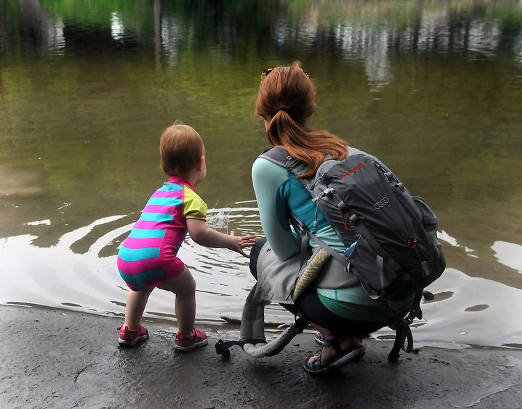 Lucia Troxell with her mother Ali Troxell, appreciating the waters along a bank of the Esopus Creek, during a Hike It Baby/ Catskills-Woodstock sponsored hike into the Esopus Bend Nature Preserve in Saugerties, NY, on Memorial Day Monday, May 30, 2016. Photo by Jim Peppler. Copyright Jim Peppler 2016.<br /> The hike was led by HIB.Catskill-Woodstock, Ambassador, Ann Peters, accompanied by her husband, John Peters, their daughter, Violet; HIB chapter co-Ambassador, Ali Troxell, with her daughter, Lucia; and Robin Willens, and her son, Landon. They entered at the Sterley Avenue entrance and walked thru to the landing area on the Esopus.
