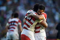 Amanaki Mafi of Japan and team-mate Yu Tamura of Japan celebrate at the final whistle. Rugby World Cup Pool B match between South Africa and Japan on September 19, 2015 at the Brighton Community Stadium in Brighton, England. Photo by: Patrick Khachfe / Stewart Communications