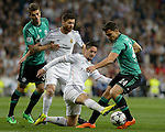 Real Madrid's forward Isco vies with Schalke's Kaan Ayhan during the UEFA Champions League football match Real Madrid CF vs Schalke 04 FC at the Santiago Bernabeu stadium in Madrid on March 18, 2014.  PHOTOCALL3000/ DP