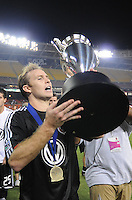 DC United defender Ryan Namoff (26) lifts the Lamar Hunt US. Open Cup Trophy after the win, DC United defeated The Charleston Battery 2-1, to win the  Lamar Hunt U.S. Open Cup at RFK Stadium in Washington DC, Saturday September 3, 2008.