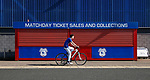 Cardiff City fan cycles past the match day ticket office during the Championship match at the Cardiff City Stadium, Cardiff. Picture date: August 15th 2017. Picture credit should read: Simon Bellis/Sportimage