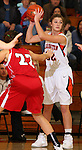 SIOUX FALLS, SD: DECEMBER 20: Anna Goodhope #22 from Washington looks for a teammate over Becky Frick #22 from Yankton in the the first half of their game Friday night at Washington. (photo by Dave Eggen/Inertia)