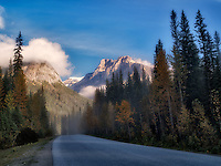Fog and road with sunrise. Yoho National Park, Britsh Colmbia, Canada.