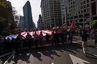 NEW YORK, USA - November 11: People attend the 100 Veterans Day parade on November 11, 2019 in New York, USA. President Donald Trump, the first sitting U.S. president attended New York's parade, where he offered a tribute to veterans ahead of the 100th annual parade  (Photo by Eduardo MunozAlvarez/VIEWpress)