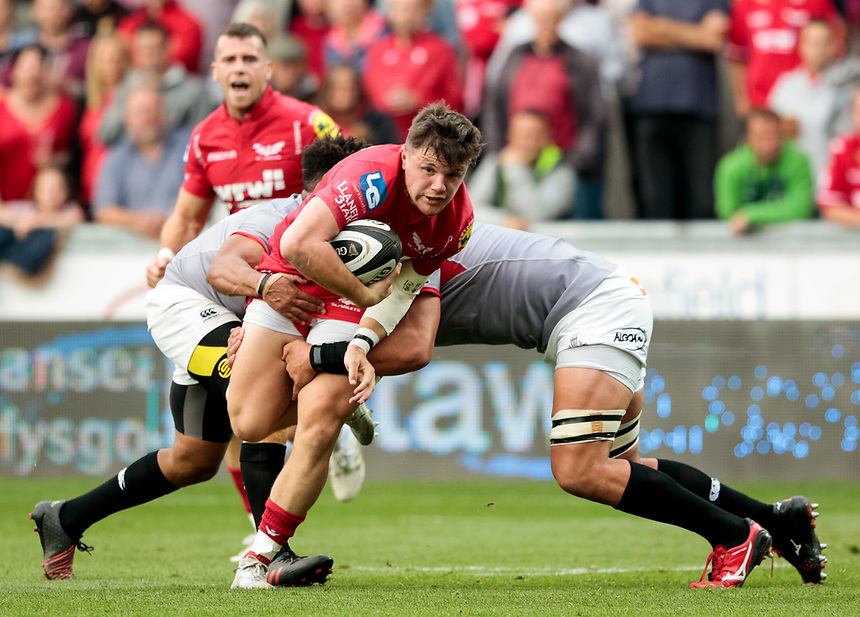 Scarlets' Steffan Evans is tackled by  Southern Kings' Kurt Coleman<br /> <br /> Photographer Simon King/CameraSport<br /> <br /> Guinness Pro14 Round 1 - Scarlets v Southern Kings - Saturday 2nd September 2017 - Parc y Scarlets - Llanelli, Wales<br /> <br /> World Copyright &copy; 2017 CameraSport. All rights reserved. 43 Linden Ave. Countesthorpe. Leicester. England. LE8 5PG - Tel: +44 (0) 116 277 4147 - admin@camerasport.com - www.camerasport.com