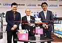 October 6, 2017, Tokyo, Japan - (L-R) Japan's online commerce giant Rakuten president Hiroshi Mikitani, Fukushima's Minamisoma city mayor Katsunobu Sakurai and convenience store chain Lawson president Sadanobu Takemasu smile as they announced Rakuten and Lawson will start a trial service to deliver Lawson's goods with Rakuten's drone in Minamisoma city end of this month in Tokyo on Friday, October 6 2017. Minamisoma's Odaka district was designated as a district under evacuation orders  due to the nuclear accident of TEPCO's Fukushima Dai-ichi nuclear plant caused by tsunami and Lawson opened the first convenience store in the area last year.    (Photo by Yoshio Tsunoda/AFLO) LWX -ytd-