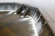 Dam at Airport Marsh near Mt Washington Regional Airport in Whitefield, New Hampshire USA during foggy conditions.