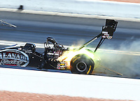 Mar 30, 2014; Las Vegas, NV, USA; NHRA top fuel driver Shawn Langdon blows a head gasket and lights it up on fire during the Summitracing.com Nationals at The Strip at Las Vegas Motor Speedway. Mandatory Credit: Mark J. Rebilas-