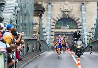 11 SEP 2010 - BUDAPEST, HUN - Alistair Brownlee leads the field over the Chain Bridge on his way to victory at the 2010 Elite Mens ITU World Championship Series Triathlon final .(PHOTO (C) NIGEL FARROW)