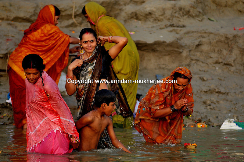 Indian women taking bath in Ganga at Varanasi, Uttar Pradesh, India.