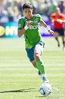 Seattle Sounders FC forward Fredy Montero (17) runs for the ball in a match against Columbus Crew at CenturyLink Field in Seattle, Washington. The Sounders defeated Columbus Crew, 6-2.