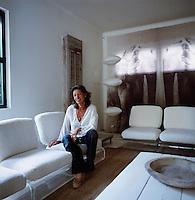 A portrait of interior designer Amelie Thiodet Vigneron seen in her living room.