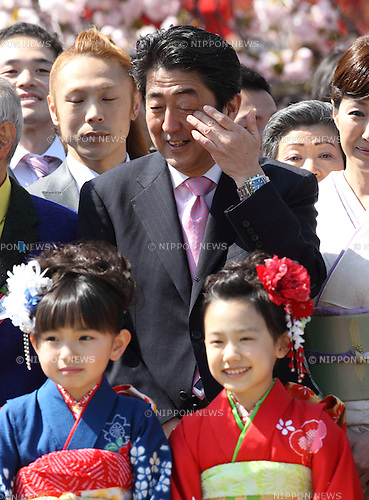 Japanese Prime Minister Shinzo Abe pose with guests for a photo session at a cherry blossoms viewing party hosted by the premier at Shinjuku-Gyoen Park in Tokyo, Japan, 12 April 2014. (Photo by Motoo Naka/AFLO)