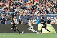 FOXBOROUGH, MA - AUGUST 3: Carles Gil #22 of New England Revolution on the attack as Jordan Harvey #2 of Los Angeles FC and Diego Rossi #9 of Los Angeles FC defend during a game between Los Angeles FC and New England Revolution at Gillette Stadium on August 3, 2019 in Foxborough, Massachusetts.