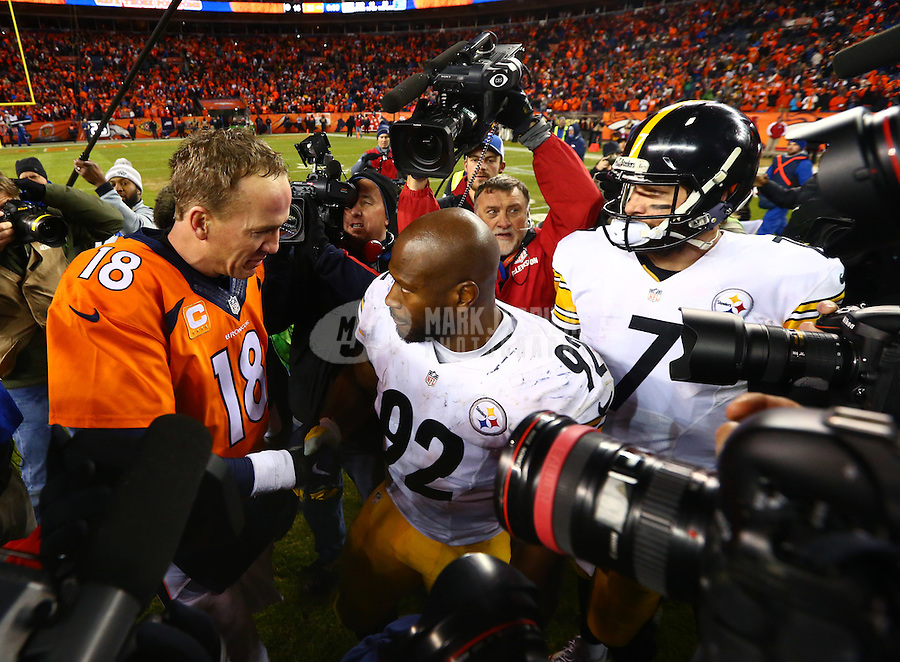 Jan 17, 2016; Denver, CO, USA; Pittsburgh Steelers linebacker James Harrison (92) and quarterback Ben Roethlisberger (7) greet Denver Broncos quarterback Peyton Manning (18) following the AFC Divisional round playoff game at Sports Authority Field at Mile High. Mandatory Credit: Mark J. Rebilas-USA TODAY Sports
