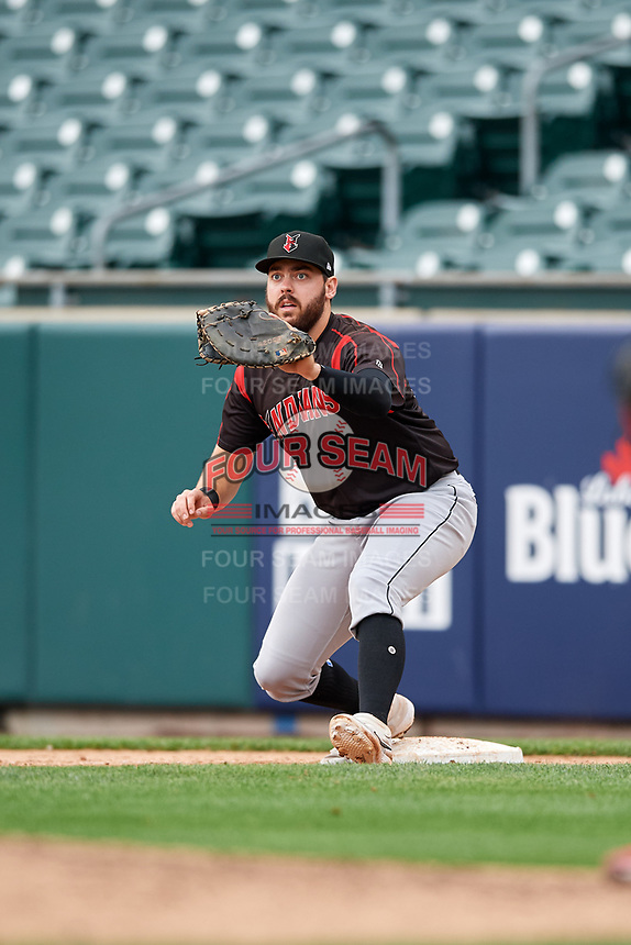 Indianapolis Indians first baseman Will Craig (25) stretches for a throw during an International League game against the Buffalo Bisons on June 20, 2019 at Sahlen Field in Buffalo, New York.  Buffalo defeated Indianapolis 11-8  (Mike Janes/Four Seam Images)