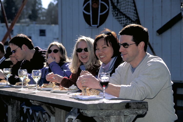 Enjoying wine and crab on the pier in Noyo Harbor during Mendocino's wine and crab days
