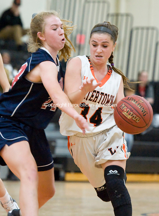 WATERTOWN, CT-011118JS10---Watertown's Chloe DeFeo (34) tries to drive past New Fairfield's Kerrigan Quinn (24) during their non-league game Thursday at Watertown High School.<br />  Jim Shannon Republican-American