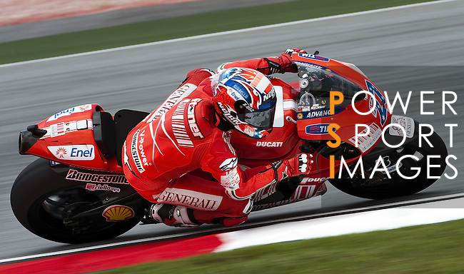 KUALA LUMPUR, MALAYSIA - OCTOBER 24:  Casey Stoner of Australia rides the #27 Ducati Marlboro Team Ducati during qualifying for the Malaysian MotoGP, which is round 16 of the MotoGP World Championship at the Sepang Circuit on October 24, 2009 in Kuala Lumpur, Malaysia.  Photo by Victor Fraile / The Power of Sport Images