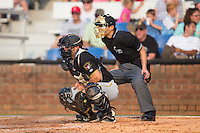 Bristol Pirates catcher Erik Lunde (18) blocks a low pitch as home plate umpire Kaz Endo looks on during the game against the Johnson City Cardinals at Howard Johnson Field at Cardinal Park on July 6, 2015 in Johnson City, Tennessee.  The Pirates defeated the Cardinals 2-0 in game one of a double-header. (Brian Westerholt/Four Seam Images)